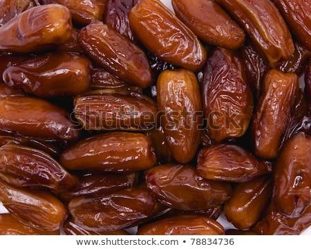 bunch dried sweet dates fruit as background stock photo © smuki