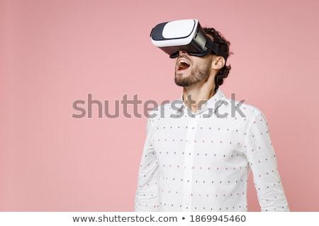 Foto stock: Shocked Man Wearing Virtual Reality Device Look Aside