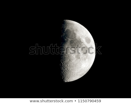 Moon in first quarter phase on a black background Stock photo © Noedelhap
