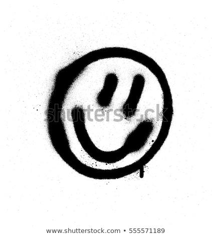 Stockfoto: Graffiti Emoticon Happy Face Sprayed In Black On White