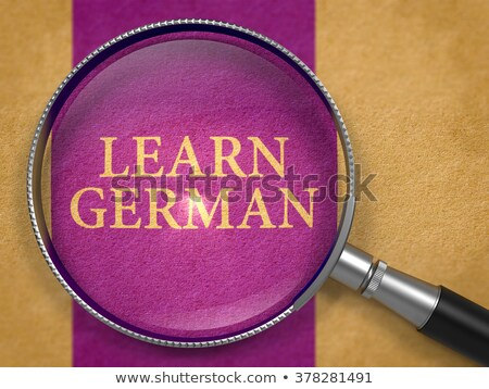 learn german through lens on old paper stock photo © tashatuvango