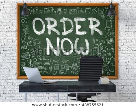order now   hand drawn on green chalkboard stock photo © tashatuvango