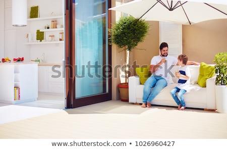 Fiatal srác ül kívül belső udvar gyermek jókedv Stock fotó © IS2