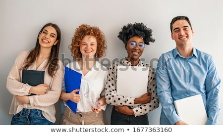 Group posing in front of wall. Stock photo © IS2