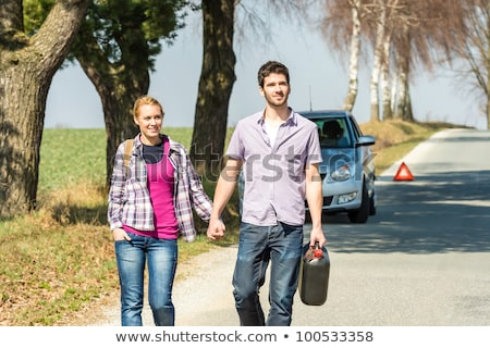 Woman walking with a gas can Stock photo © IS2