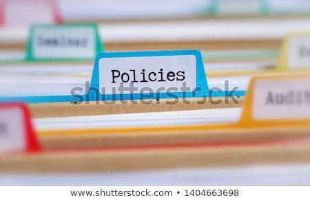 business insurance concept on file label stock photo © tashatuvango