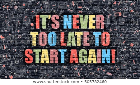 its never too late to start again on dark brick wall stock photo © tashatuvango