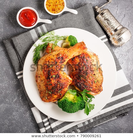 Grilled chicken legs on wooden background.Rustic dinner table. stock photo © Virgin