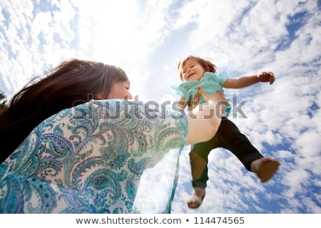 Girl thrown in air Stock photo © IS2