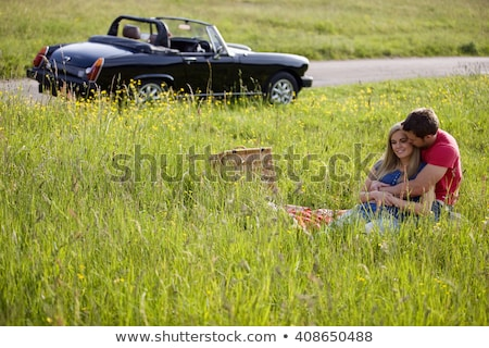 Couple laying in a convertible Stock photo © IS2