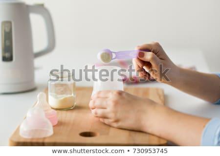 mother making baby formula in milk bottle stock photo © stevanovicigor