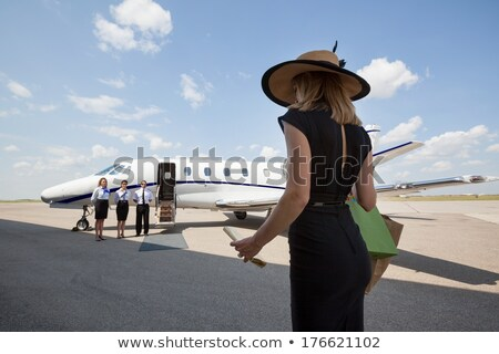 Female pilot in front of private jet. Stock photo © IS2