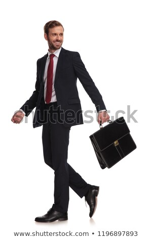 Stock photo: side view of confident businessman in navy suit stepping