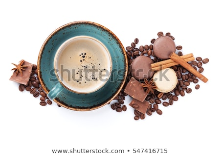 cup of coffee with spices and macaron stock photo © dash