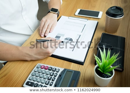 businessman going through some paperwork and signing a document  Stock photo © snowing