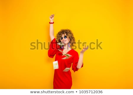 Attractive woman with short curly hair with cash Stock photo © Traimak