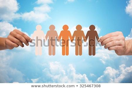Mani catena persone pittogramma cielo Foto d'archivio © dolgachov