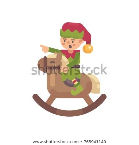 Cute Рождества эльф верховая езда игрушечный конь-качалка Дед Мороз Сток-фото © IvanDubovik