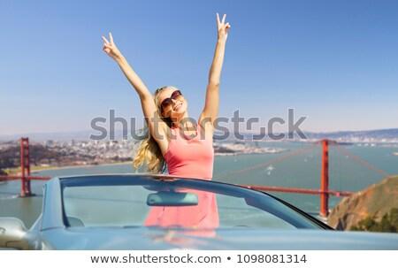 woman driving convertible car over san francisco Stock photo © dolgachov