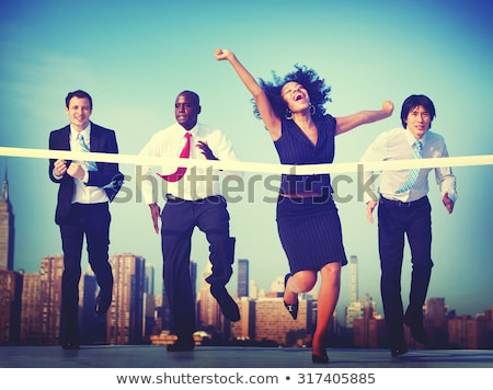 Successful winner businesswoman on the finishing line Stock photo © alphaspirit
