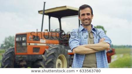 Genç çiftçi çiftlik çiftlik hayvanları çim doğa Stok fotoğraf © colematt