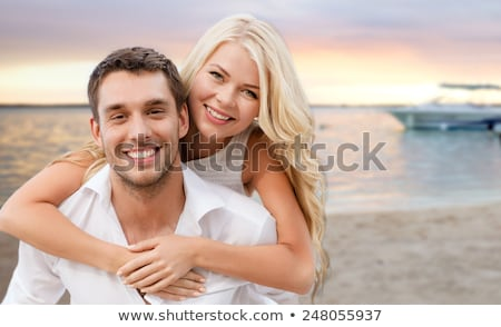 Stock photo: happy couple on vacation over tropical beach