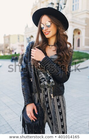 Stylish spring look with striped overalls and leather jacket. Stock photo © studiolucky