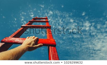 ambitny · biznesmen · górę · działalności · chmury · świetle - zdjęcia stock © elnur