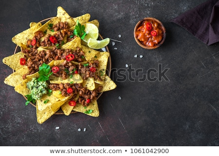 Mexican corn nacho spicy chips served with melted cheese Stock photo © dash