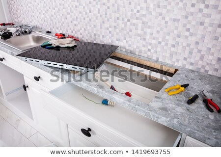 Installation Of New Induction Hob And Sink In Kitchen Stock photo © AndreyPopov