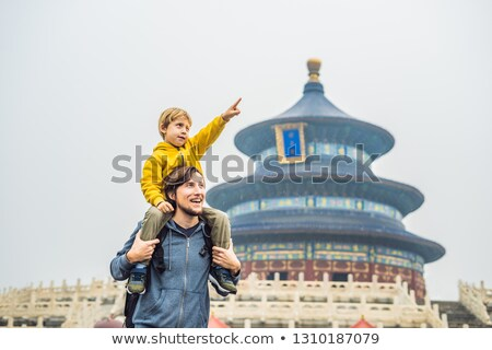Dad and son travelers in the Temple of Heaven in Beijing. One of Stock photo © galitskaya