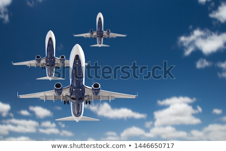 Bottom View of Three Passenger Airplanes Flying In The Blue Sky Stock photo © feverpitch
