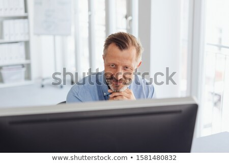 Dedicated senior businessman working at a desktop Stock photo © Giulio_Fornasar