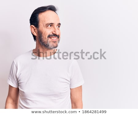 Handsome man smiling at summer stock photo © nyul