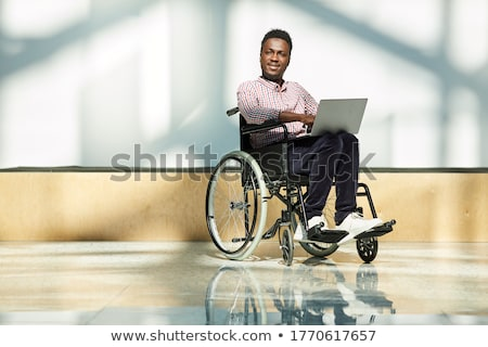 businessman sitting on wheelchair stock photo © andreypopov