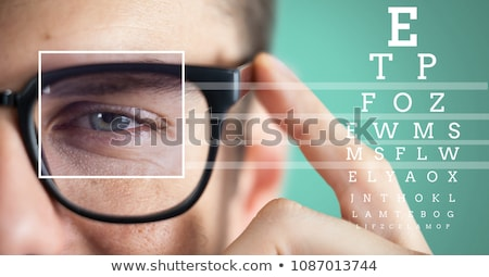 man with eye focus box detail over glasses and lines and Eye test interface Stock photo © wavebreak_media