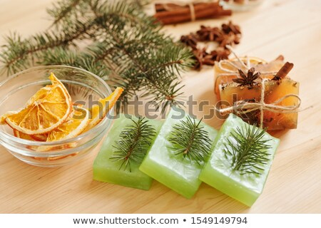 handmade soap bars with conifer and aromatic spices and orange slices in bowl stock photo © pressmaster