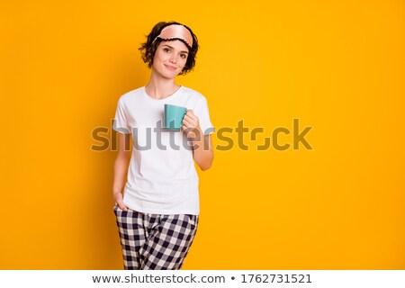 woman in pajama and sleeping mask drinking coffee Stock photo © dolgachov