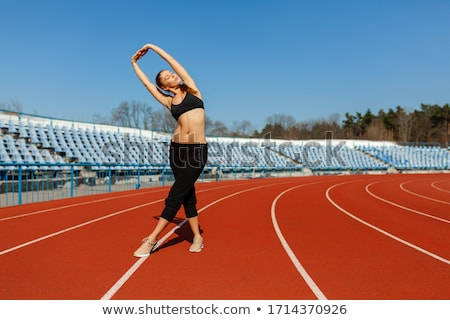 Athlete warm up stretch on athletics running track stock photo © darrinhenry