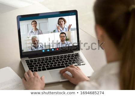 A team of doctors conferring Stock photo © photography33