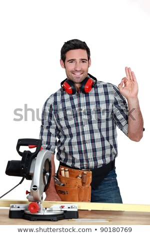 Man with circular saw making OK gesture Stock photo © photography33