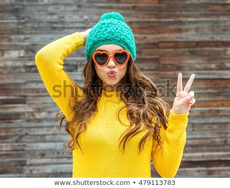 lovely brunette in winter hat stock photo © dolgachov