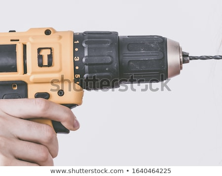 Woman holding a driller. Stock photo © photography33