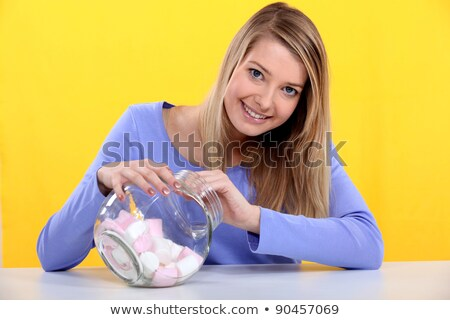 Gourmand woman eating marshmallows Stock photo © photography33