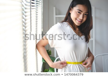 Maßband · herum · Frau · Taille · isoliert - stock foto © stockyimages