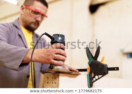 Closeup of a carpenter using a power wood sander Stock photo © williv