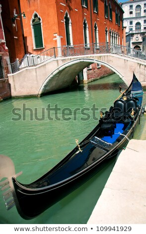 Venetian gondola at its mooring Stock photo © mariematata