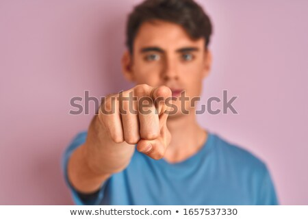 Casual teen guy pointing at you Stock photo © stockyimages