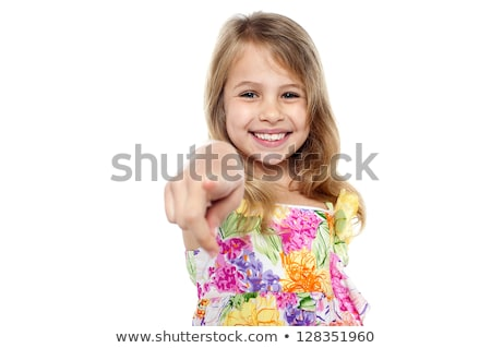 Fashionable trendy girl pointing towards camera stock photo © stockyimages