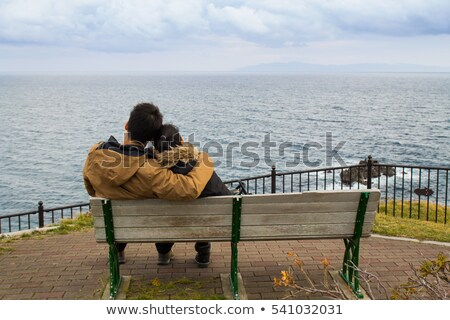 Stock photo: Young loving Couple siting on the beach